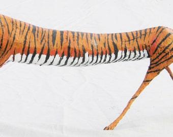 Papier mache sculpture of a tiger, elongated style