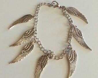 7in Silvertone wings bracelet