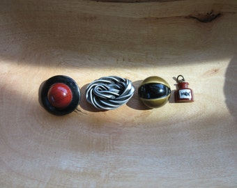 Four Odd Vintage Buttons