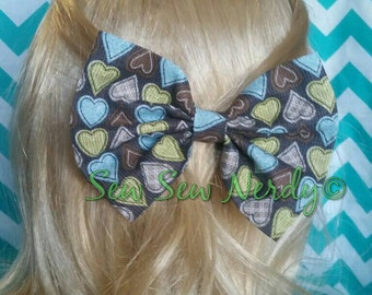 Brown heart bow