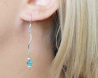 Silver Curvy Dangle Earring with Blue Crystal