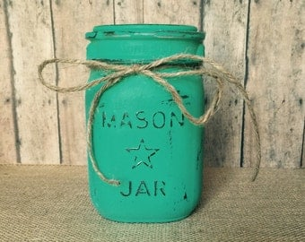 Turquoise colored hand painted pint size mason jar
