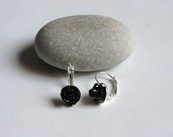 Long earrings with black rose