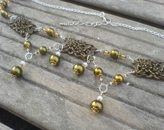 Necklace with bronze glass beads