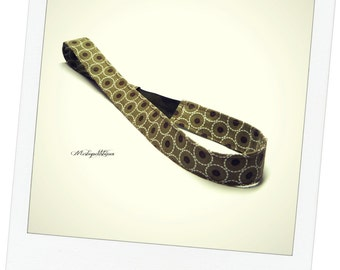 Brown fabric headband in geometric shapes