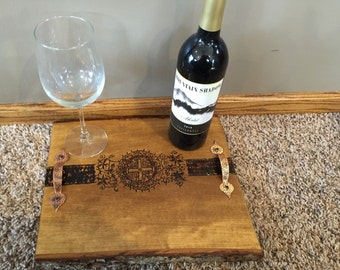 Wooden platter with a cross design