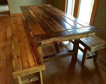 Beautiful reclaimed dining table with benches