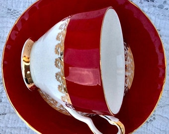 Beautiful Red And Gold Sutherland Teacup and Saucer