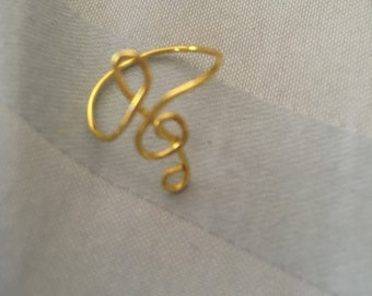 treble clef knuckle ring