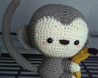 Amigurumi monkey with banana