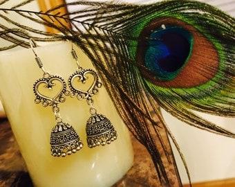 Cute heart shape bead with german silver jumka earrings.