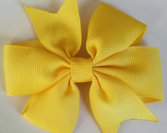 Yellow bow by RoselliesClosetshop