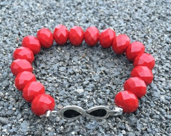 Red bracelet with Infinity symbol