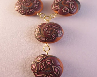 Handmade round stars and swirl polymer clay beads necklace.