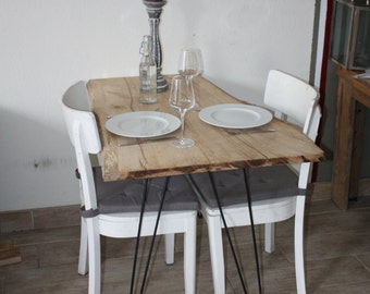 Dining table from blank oak, with legs of reinforcing bars