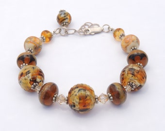 Gorgeous Lampwork glass beaded bracelet with dangle.