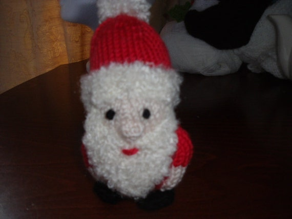 Father Christmas hand knitted stuffed toy.