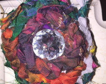 Vintage looking flower pin crystal center magnet back julies bloomies