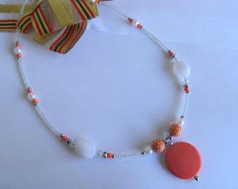 Orange and white beaded necklace