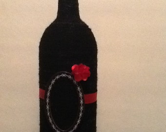 Recycled wine bottle made into a picture frame.