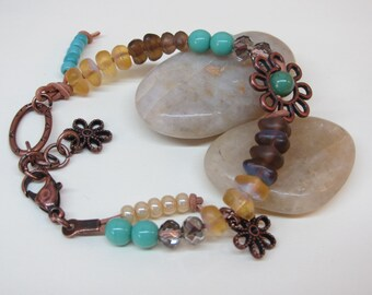 Earthy knotted leather bracelet,  Smokey glass beads, turquoise blue glass beads and copper charms