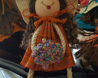 Doll in string with wood base 10 inch