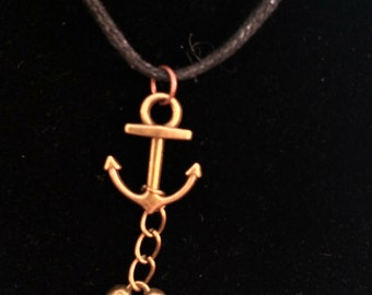 brass tone anchor with dolphin heart on a hemp necklace