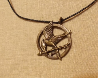 "A pendant ""The Mockingjay"" from ""The Hunger Games"""