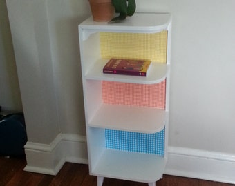 Cute white corner bookshelf with gingham accents