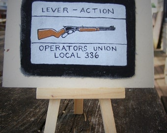 lever action rifle, painted patch study with easel