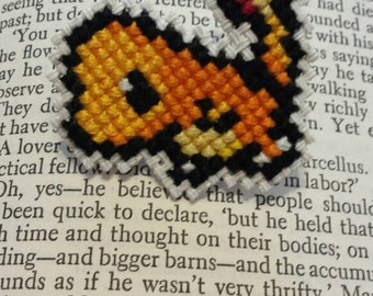Hand made Charmander cross stich pin