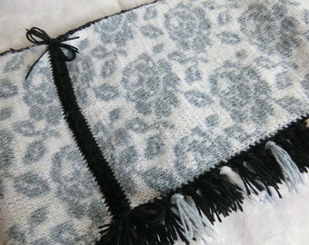 Loop, snood for turning hand knitted in white, grey and black wool with fringes, double-face technique