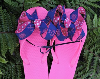 pink flops with navy blue and pink anchor ribbon