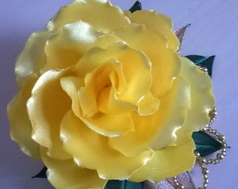 Yellow flower on hairclip