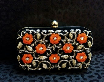 Floral Clutch with the Coral Orange