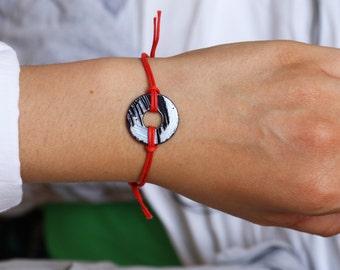 Unisex bracelet with engraved washer pendant.
