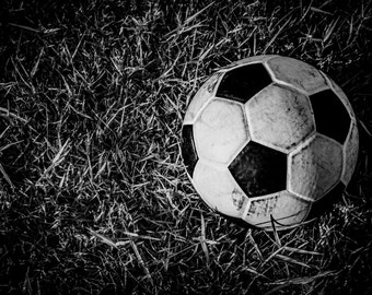 A football on grass background with Black and white filter