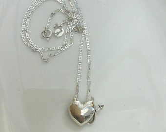 Sterling Silver heart with little devil horns and tail on a Sterling Silver chain
