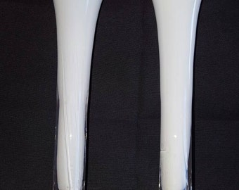 A set of tall white vases