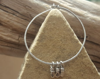 Large, hammered, sterling silver hoops with sterling silver beads