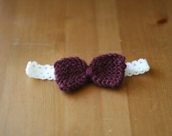 Baby bow on stretchy headband in burgundy