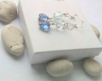 Earings with sky blue glass bead, and silver metal wire design