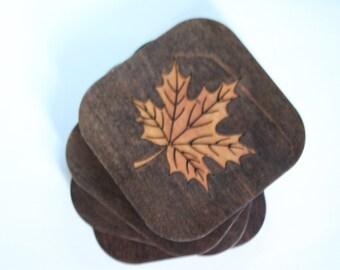 Set of four wood, maple leaf coasters