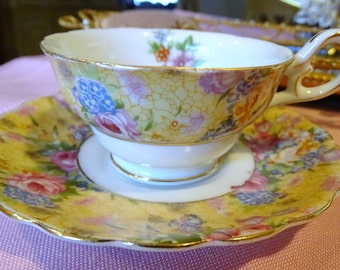 Occupied Japan Chintz  Floral   Footed TEA CUP & SAUCER