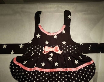 Dress in black with white stars. Beautiful black dress with white stars and a hint of pink.
