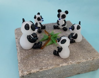 Family of Pandas with Bamboo