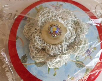 Crocheted brooch with button and glass stones embellishment.