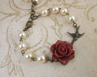 Coral Flower Ivory Pearl and Brass Swallow Bracelet
