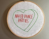 Naked dance party - hand drawn and embroidered converstion heart wall hanging