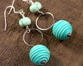 Teal green and white swirl beads, flower polymer clay, and silver ring handmade earrings